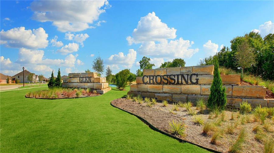 entrance to a suburb with landscaped design and green grass