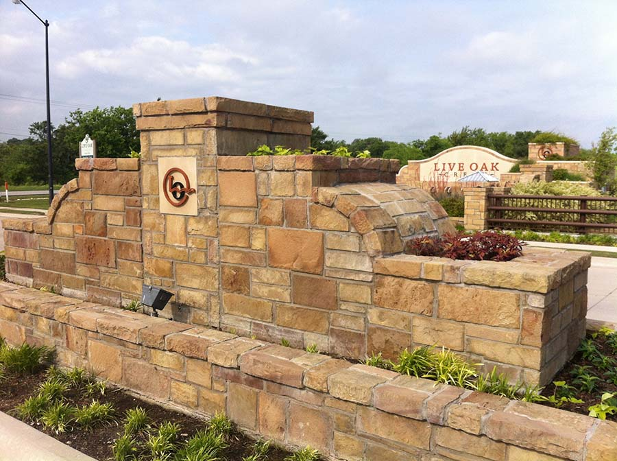 bricked welcome sign viewed from the back