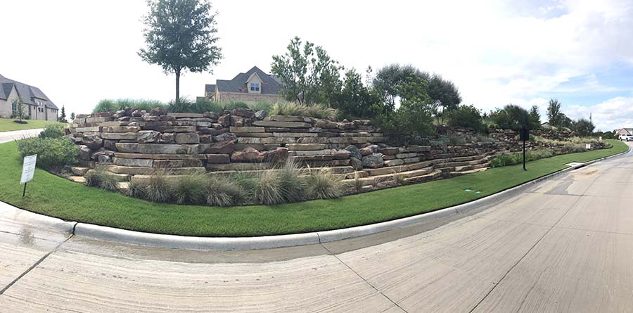 landscaped sidewalk of a suburb with layers of flat rocks