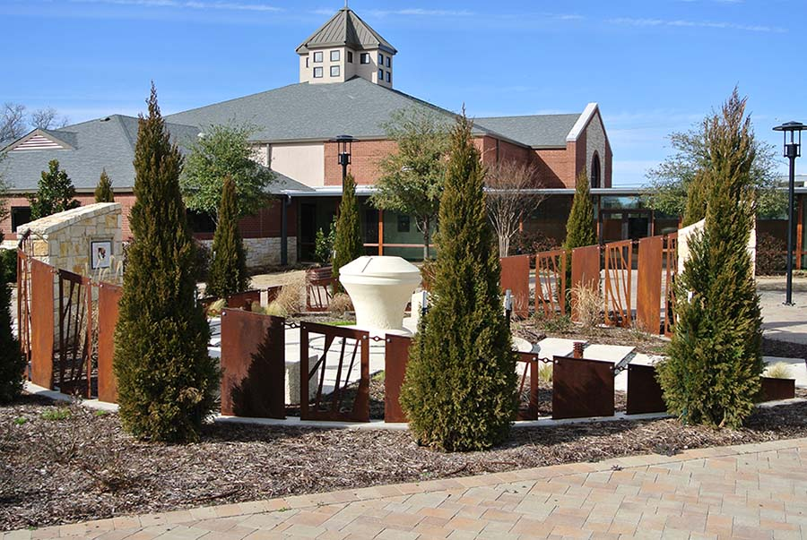 fenced segment of a sculpture garden