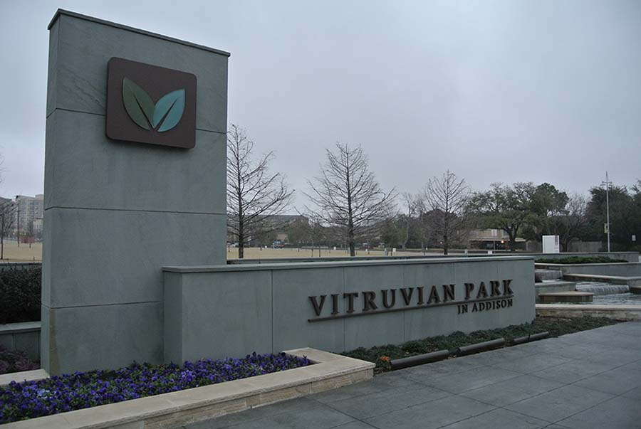 entrance sign of a park with concrete materials and square designs