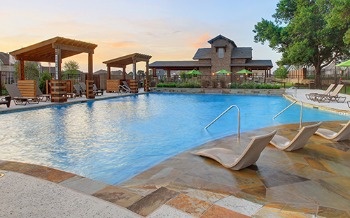 pool with shaded areas and lounge chairs