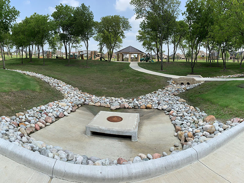 park with drainage made of smooth rocks