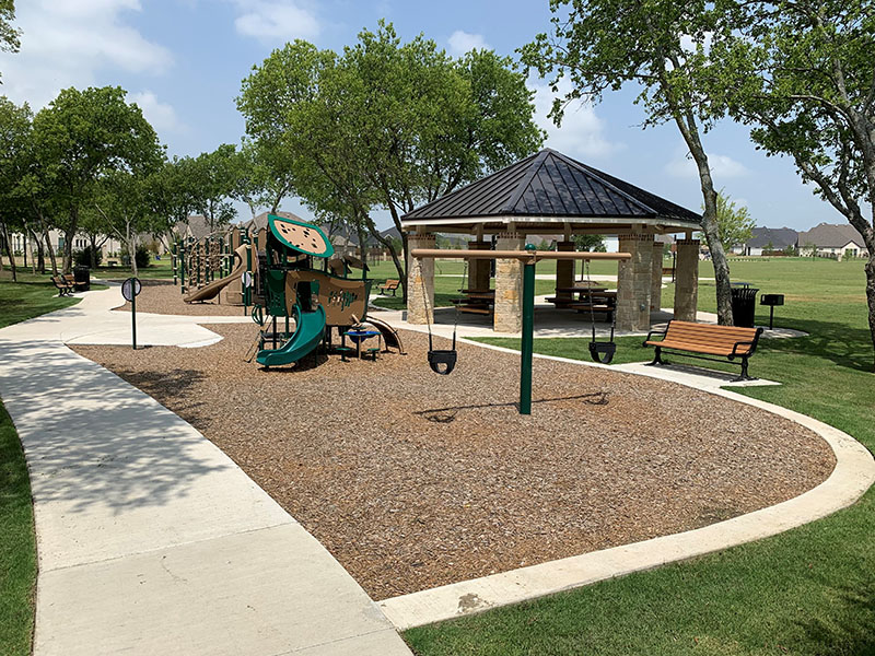 playground with a gazebo and play structures