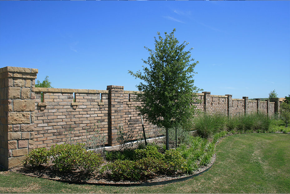 brick wall with landscaped surrounding
