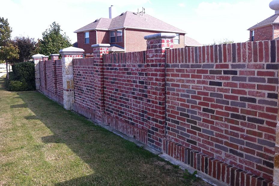 wall with bricks of various shades of red