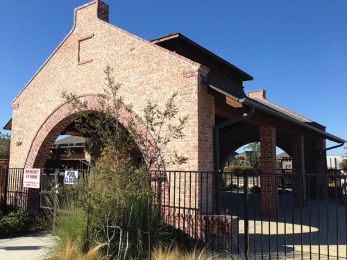 brick house with metal fencing and open walls
