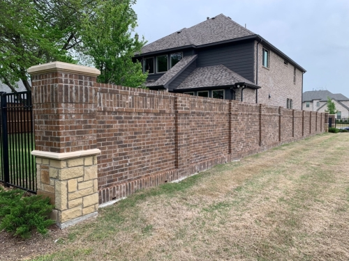 brick walls surrounding a house